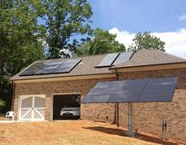 Roof-mounted PV, ground-mounted PV, and solar thermal arrays with battery backup