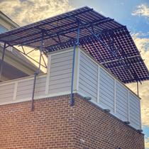 Custom 2nd story pergola providing shade and solar production with LG bifacial panel