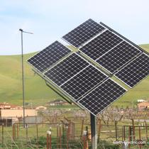 A windmill and her ground-mounted solar sister! What if everyone had such energy-makers? Would we need to rely on fossil fuels anymore? -2013, Hollister, CA.  Suniva solar panels. Schneider Electric inverter.