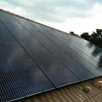 All Black panels on a tile roof in Vero Beach, FL