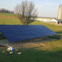 Ground mounted solar array with timber and stone