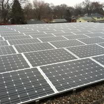 Commercial 39.75 kW Array on a flat roof.