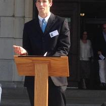 Sol Power's Eric Beecher speaking at the RI statehouse about the importance of green energy to address climate change