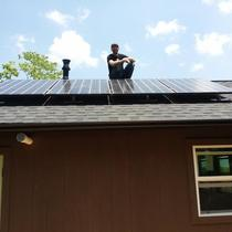 Mike at an off-grid install at Franny's Farm