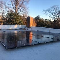 Flat roof, non-penetration installation in DC