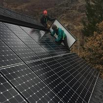 The Brightside Solar team installing panels in autumn