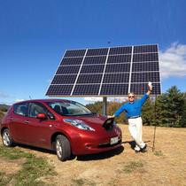 An AllSun solar tracker installed.  Owner Fred Garbo shows off his Nissan LEAF now 100% powered by solar!