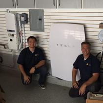 This Tesla Energy Powerwall battery will provide peak shaving and back up energy storage for night use! The solar panels charge the battery!